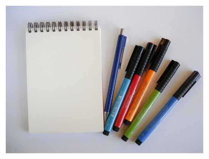 Drawing notebook and colourful pens to capture my imagination