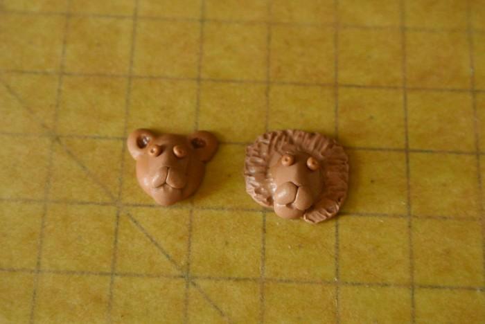 Lion earrings - working on models