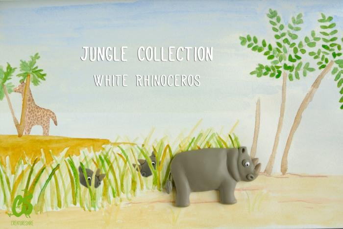 White rhinos wandering through the lush grass