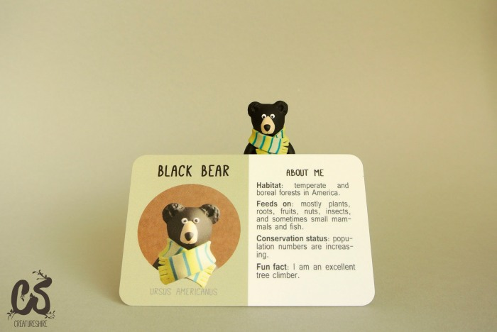 Collectible creature card featuring the black bear