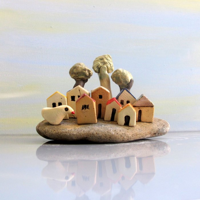 Miniature houses in a beach stone  Image credits by Edna Pio