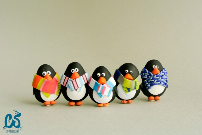 A happy bunch of cute penguin brooches in cosy scarves